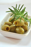 Olives and rosemary Stock Photos