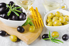 Olives, rosemary and olive oil Royalty Free Stock Photo