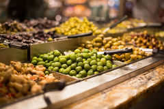 Olives on sale/display in a food market Stock Photo