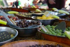 Olives for sale at outdoor farmers market street scene royalty free stock images