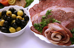 Olives and sausage Royalty Free Stock Images
