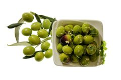 Olives seasoned with oil, salt, parsley and garlic on a white ba Stock Photo