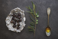 Olives in silver foil Stock Image
