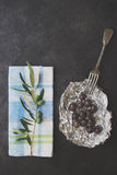 Olives in silver foil Stock Images