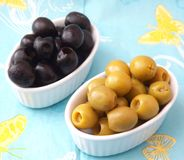 Olives. Some fresh green and black olives royalty free stock photos