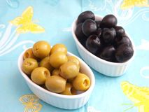 Olives. Some fresh green and black olives in bowls stock photos
