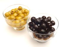 Olives. Some fresh green and black olives in vinegar royalty free stock images