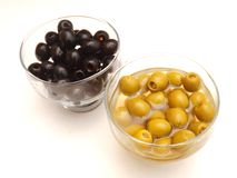 Olives. Some fresh green and black olives in vinegar royalty free stock image