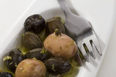 Olives, spice, oil and fork Royalty Free Stock Photos