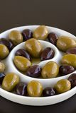 Olives in spiral dish. Green and Black olives in a sprial bowl Stock Photos