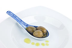 Olives on  spoon. Stock Photography