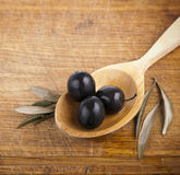 Olives on  spoon Stock Photography