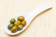 Olives in a spoon Stock Photos