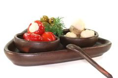 Olives, stuffed peppers and mushrooms Royalty Free Stock Photo