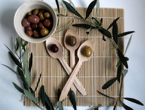 Olives. On three wooden spoons Royalty Free Stock Photography