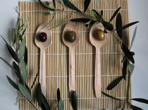 Olives. On three wooden spoons Royalty Free Stock Images