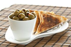 Olives and toast Stock Image