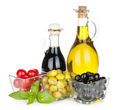 Olives, tomatoes, herbs and condiments Royalty Free Stock Photography