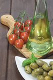 Olives, tomatoes and olive oil. Vertically. Stock Image