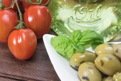 Olives, tomatoes and olive oil Stock Photography