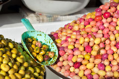 Olives under bright sun. At the Marrakkesh market Royalty Free Stock Images