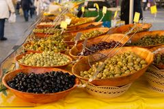 Olives and vegetables for sale at farmers market royalty free stock image