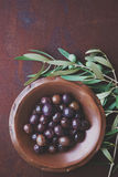 Olives in vintage plate Stock Photo