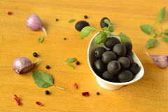 Olives in a white bowl Stock Photos
