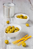 Olives in white bowls Royalty Free Stock Photos