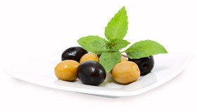 Olives on white plate Stock Photography