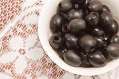 Olives on white tablecloth Stock Image