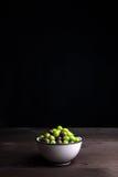 Olives on wood Stock Image