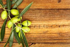 Olives on wood Stock Photos