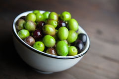 Olives on wood Stock Images
