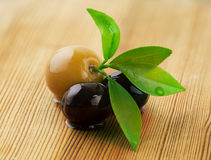 Olives  on a wooden background. Royalty Free Stock Images