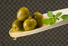 Olives on wooden spoon Royalty Free Stock Photos