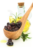 Olives in a wooden spoon Stock Photography