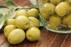 Olives on a wooden table Stock Photos