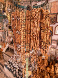 Olivewood rosaries with often purchased in the old part of Jerus Stock Photos