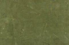 Olivgrön bomullstextur med skrapaans-revor Arkivbild
