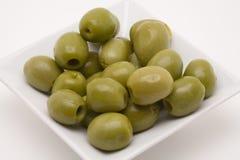 Olivgrüner Aperitif Stockbild