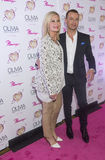 Olivia Newton-John - Summer Nights. LAS VEGAS, - APRIL 11: Entertainer Olivia Newton-John (L) and actress Joey Lawrence attends the grand opening of her Royalty Free Stock Images
