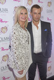 Olivia Newton-John - Summer Nights. LAS VEGAS, - APRIL 11: Entertainer Olivia Newton-John (L) and actress Joey Lawrence attends the grand opening of her Royalty Free Stock Photography
