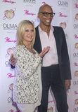 Olivia Newton-John - Summer Nights. LAS VEGAS - APRIL 11: Entertainer Olivia Newton-John (L) and television personality RuPaul attends the grand opening of her Stock Image