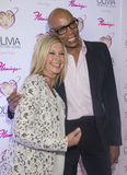 Olivia Newton-John - Summer Nights. LAS VEGAS - APRIL 11: Entertainer Olivia Newton-John (L) and television personality RuPaul attends the grand opening of her Stock Images