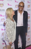 Olivia Newton-John - Summer Nights. LAS VEGAS - APRIL 11: Entertainer Olivia Newton-John (L) and television personality RuPaul attends the grand opening of her Royalty Free Stock Photography