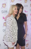 Olivia Newton-John - Summer Nights. LAS VEGAS - APRIL 11: Entertainer Olivia Newton-John and singer Marie Osmond attends the grand opening of her residency show Royalty Free Stock Images