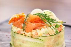 Olivier salad with salmon and tobiko caviar. Royalty Free Stock Image