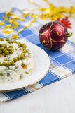 Olivier salad on a table with Christmas decorations. Christmas C Stock Photography