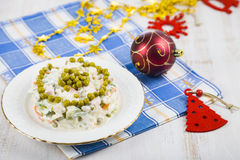Olivier salad on a table with Christmas decorations. Christmas C Royalty Free Stock Photography